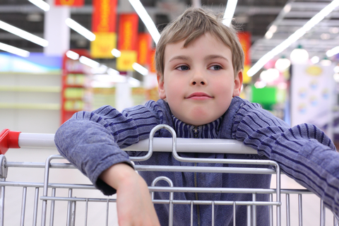 Boy with shopping cart